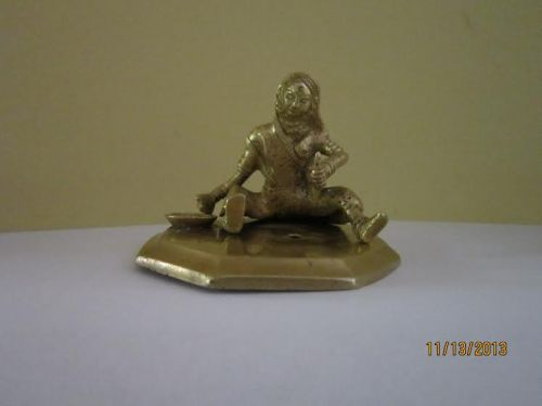 brass figurine woman with hand mill