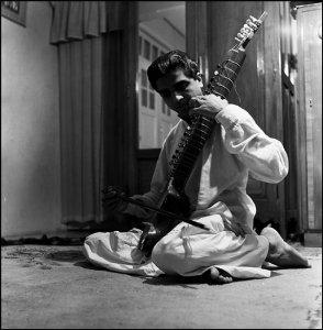 Ushakant playing the sitar