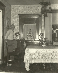 Granddad in the dining room decorated for Christmas
