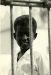 a boy at the Bondere compound gate